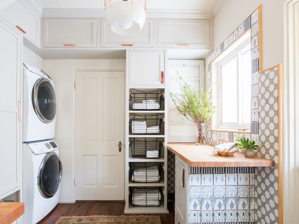 Laundry room makeover idea, stackable washer and dryer to save space.  Image source: HGTV - Tessa Neudstadt