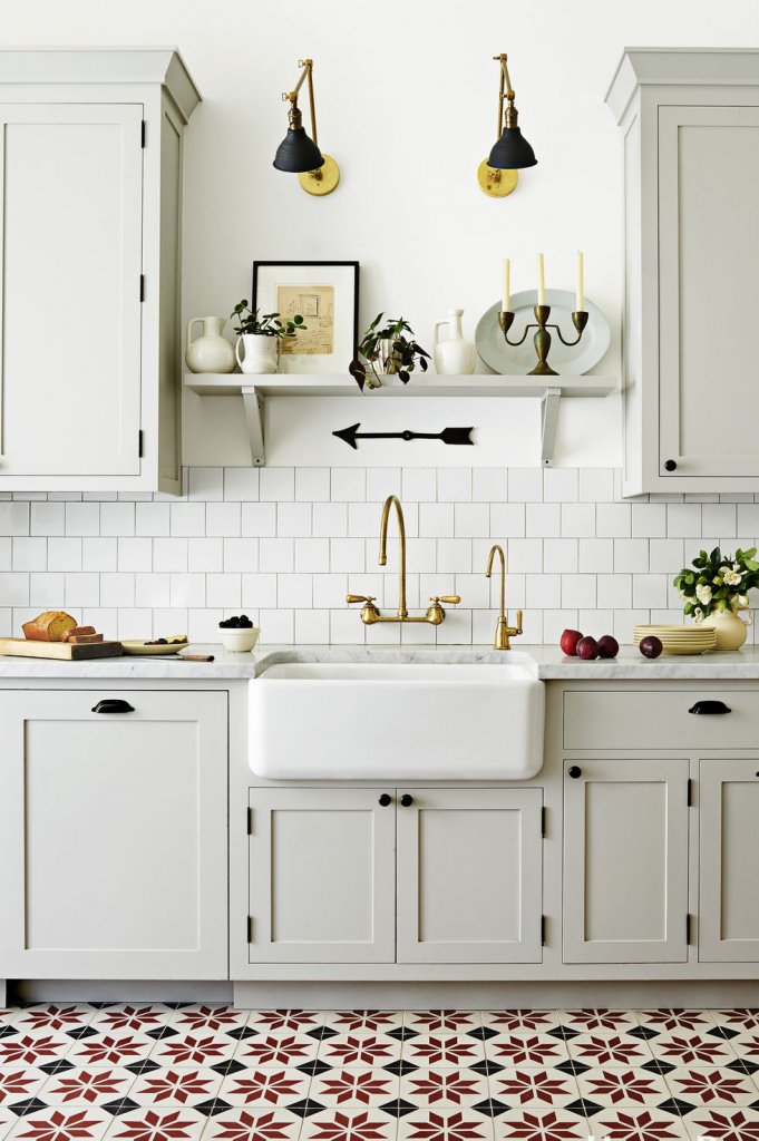 Stylish Small Kitchens, install a shelf above the sink, between cabinets, for extra space.