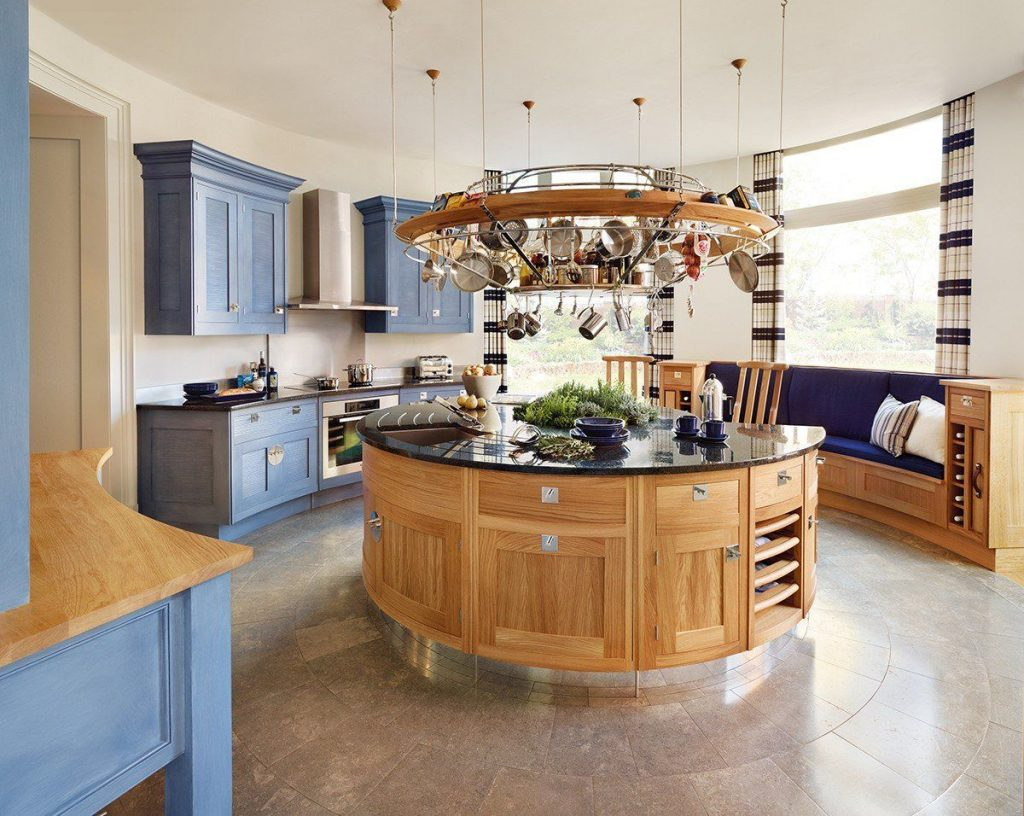round kitchen island with wood cabinets