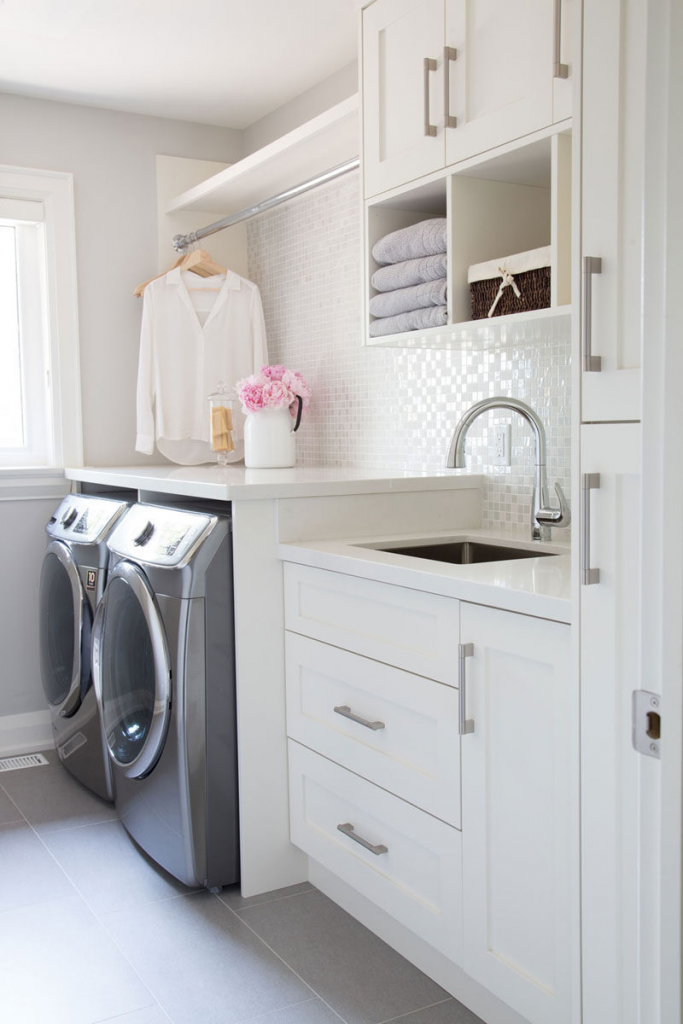 laundry room makeover idea, simply replace your laundry room cabinet doors.   Image source: Contemoporist https://www.contemporist.com/7-ideas-for-making-your-laundry-room-more-organized/