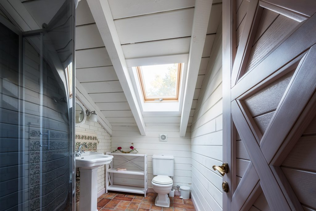 interior of bathroom in modern cottage house
