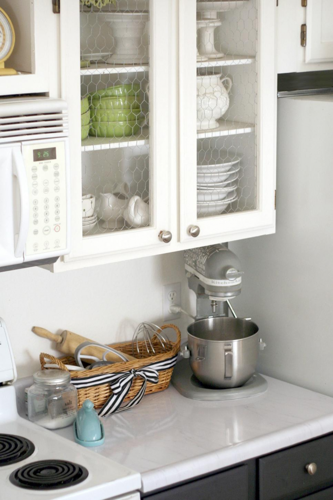 white kitchen cabinets with chicken wire instead of glass