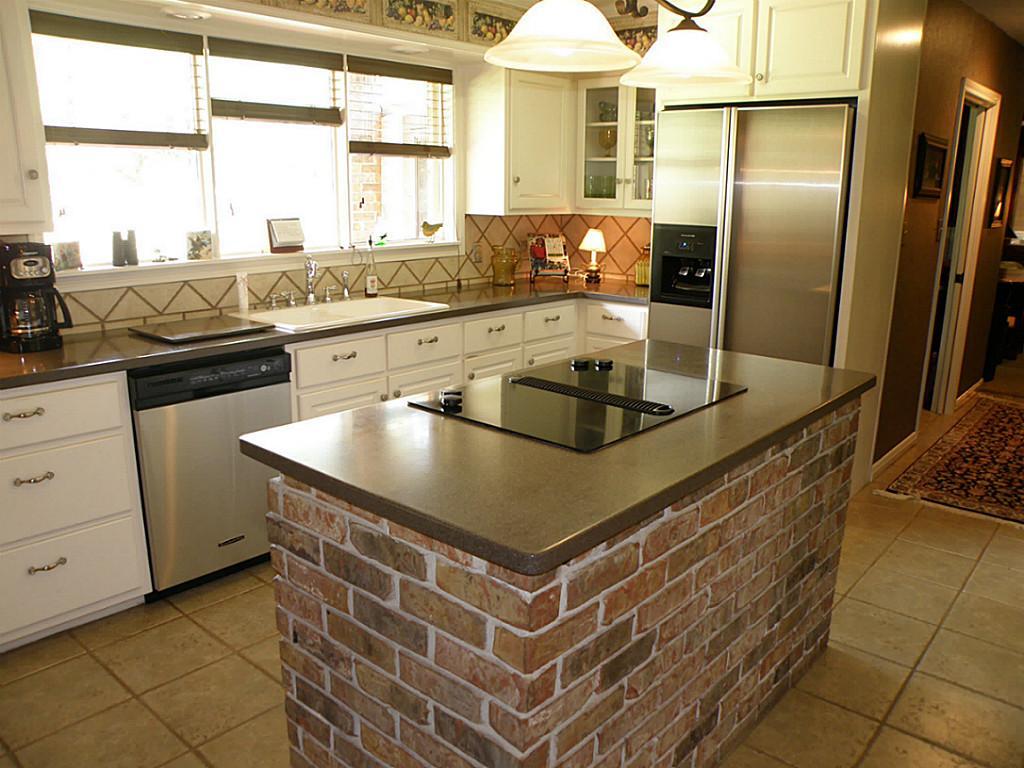 brick kitchen island with steel appliances