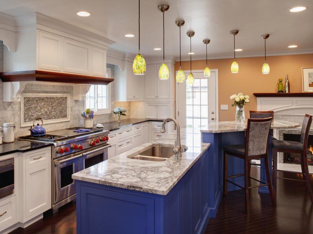 blue cabinets on a multi-level kitchen island