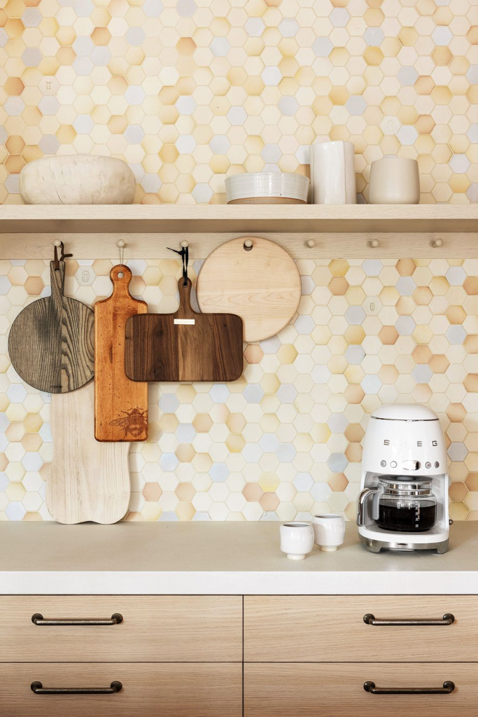 use cutting boards and utensils as artwork in the kitchen