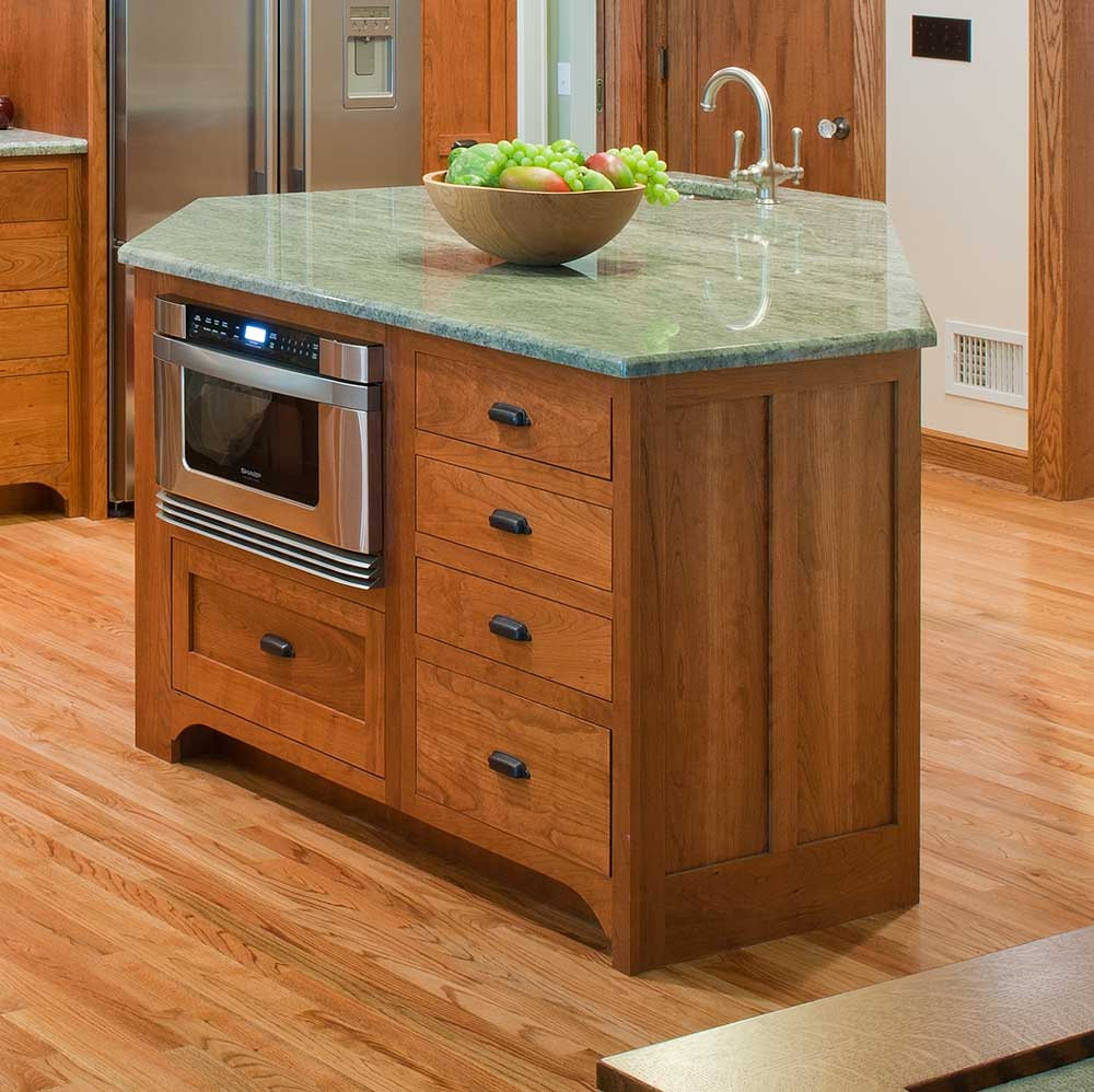 wood cabinets with green counter and built-in appliances