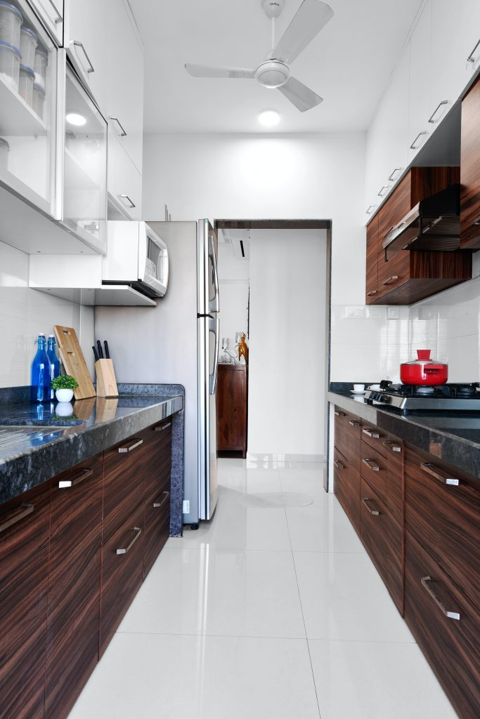 galley kitchen with upper cabinets