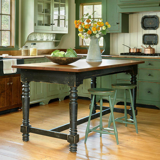 bar height table being used for dual use, as a table and an island