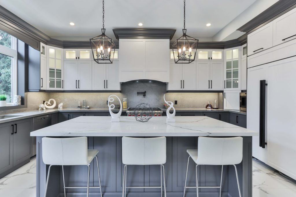 deep gray lower cabinets, white upper cabinets, matte black finishes