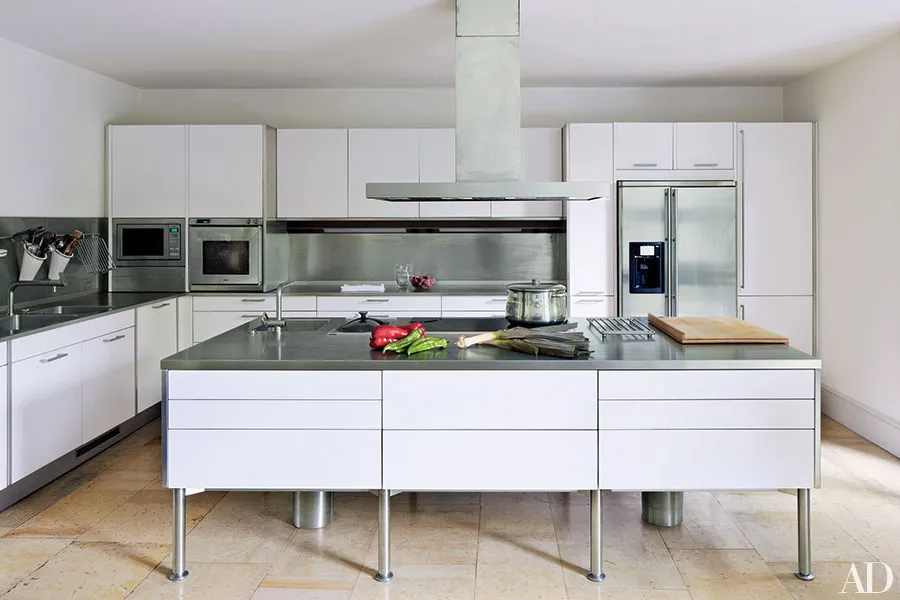 white and gray kitchen cabinets with stainless steel legs, industrial style kitchen