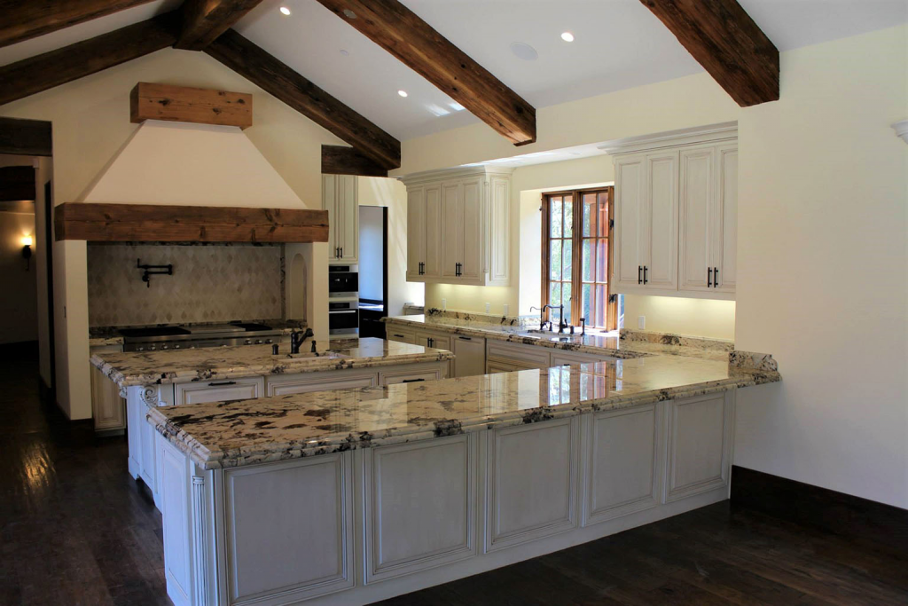 Country Style kitchen, muted, warm-tones neutral hues, dark wood furniture.   Source: Oakridge Cabinets