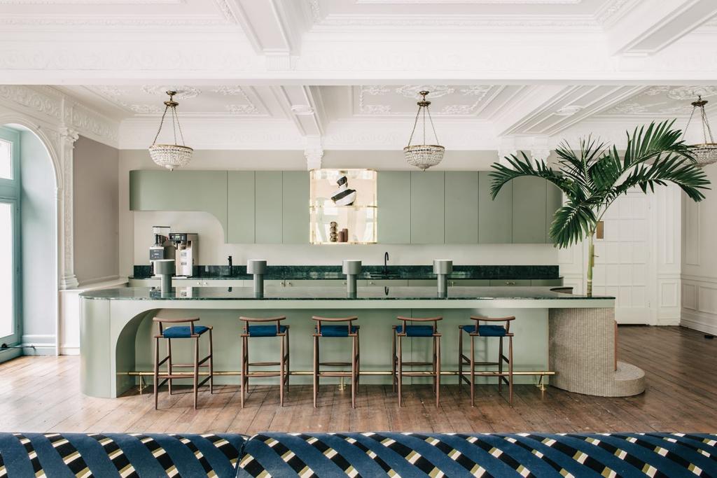 Mid-Century Modern Kitchen, simplicity and minimalism abound.   Source: sella-concept.com/work/huckletree/