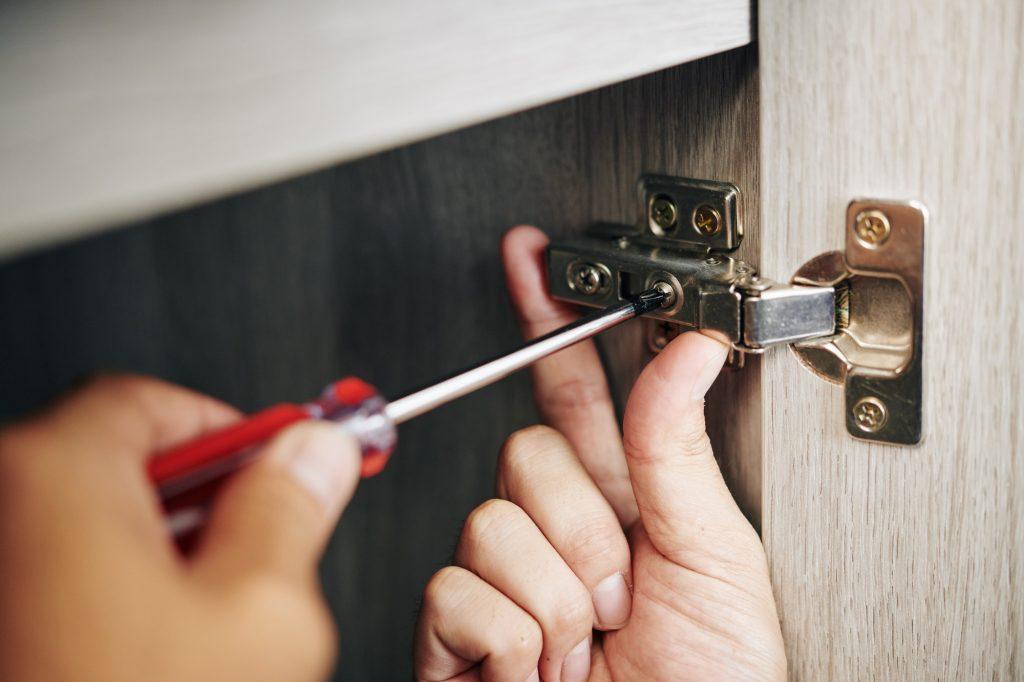 Man install and adjust cabinet door hinge
