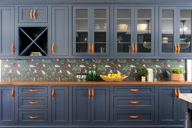 Blue cabinets with mesh installed. Source: Raychel Wade Interiors