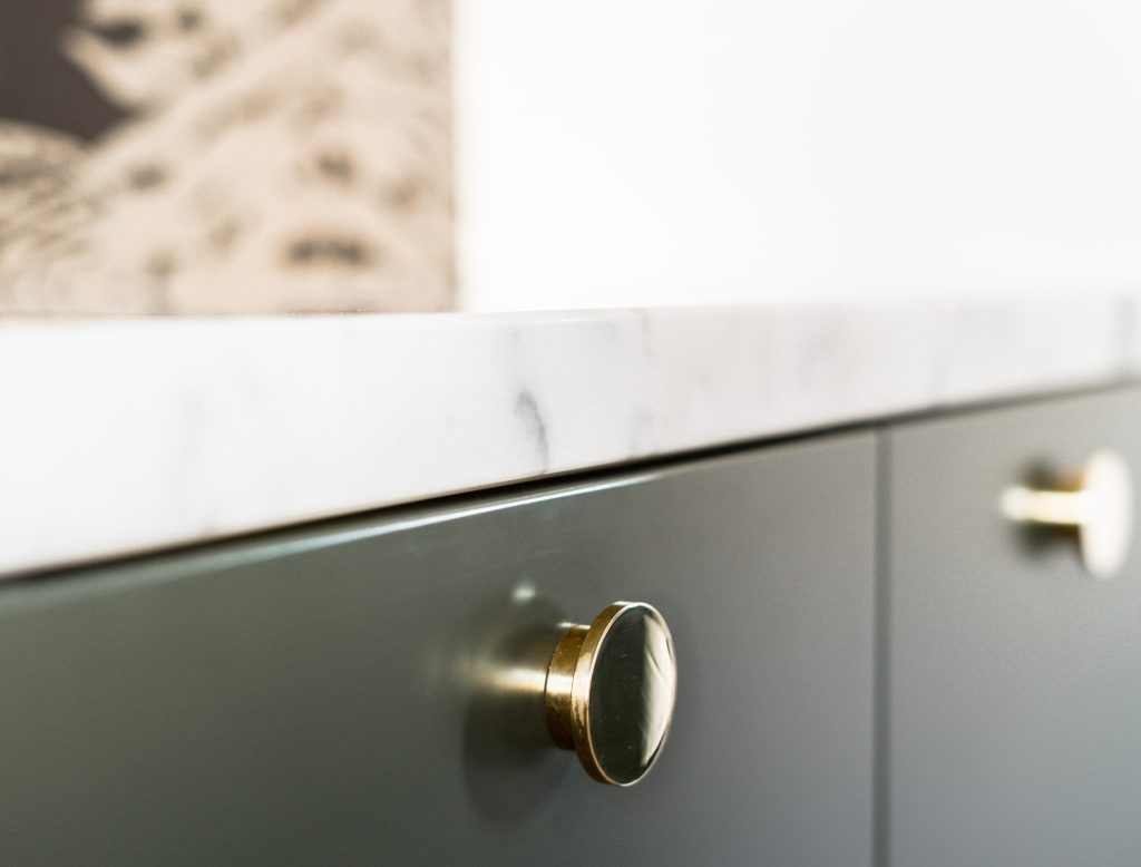 Green cabinet drawer with golden knob