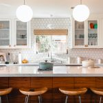Painting oak cabinets white can make a kitchen look completely different.